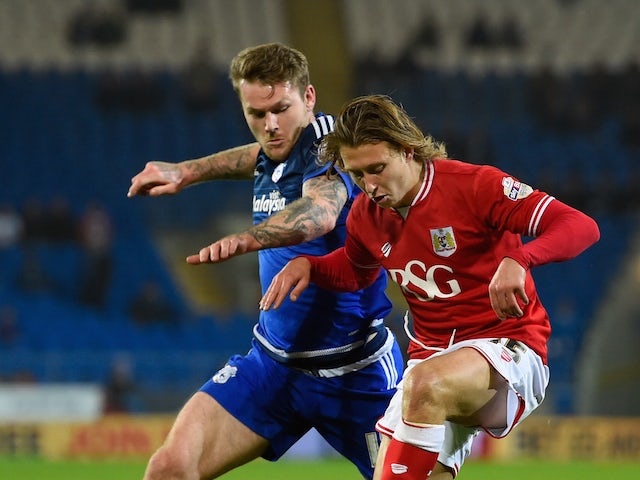 Bristol City player Luke Freeman (r) holds off the challenge of Aron Gunnarsson of Cardiff during the Sky Bet Championship match between Cardiff City and Bristol City at Cardiff City Stadium on October 26, 2015 in Cardiff, United Kingdom.