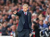 Arsene Wenger Manager of Arsenal gestures during the Barclays Premier League match between Swansea City and Arsenal at Liberty Stadium on October 31, 2015