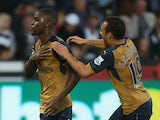 Joel Campbell (L) of Arsenal celebrates scoring his team's third goal with his team mate Santi Cazorla (R) during the Barclays Premier League match between Swansea City and Arsenal at Liberty Stadium on October 31, 2015