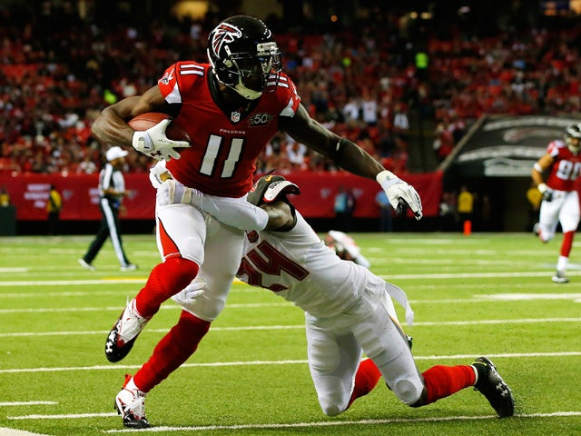 Julio Jones #11 of the Atlanta Falcons is tackled after a catch by Mike Jenkins #24 of the Tampa Bay Buccaneers during the first half at the Georgia Dome on November 1, 2015