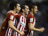 Atletico Madrid's Portuguese midfielder Tiago celebrates with teammates Uruguayan defender Diego Godin and midfielder Gabi after scoring a goal during the Spanish league football match RC Deportivo La Coruna vs Club Atletico de Madrid at the Municipal de