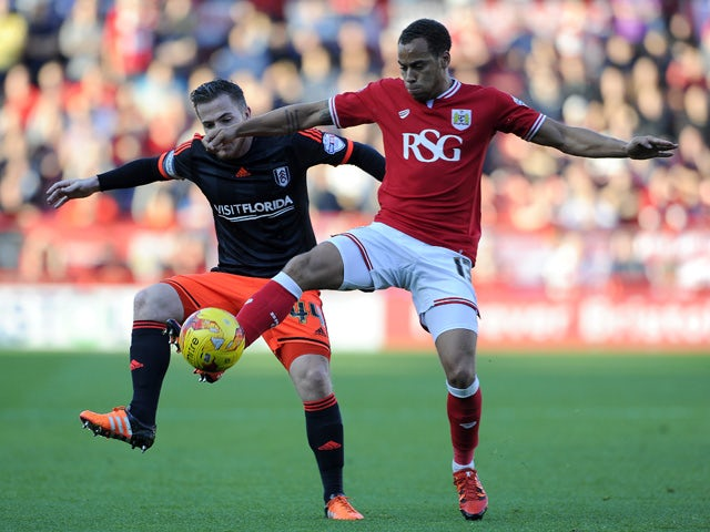 Elliot Bennett of Bristol City is tackled by Ross McCormack of Fulham during the Sky Bet Championship match between Bristol City and Fulham at Ashton Gate on October 31, 2015