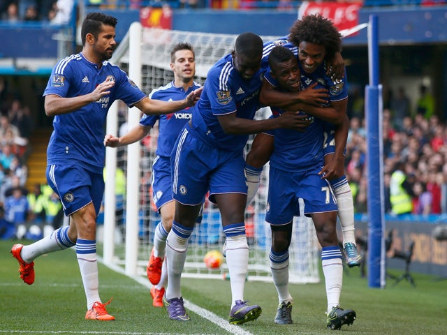 Ramires (2nd R) of Chelsea celebrates scoring his team's first goal with his team mates during the Barclays Premier League match between Chelsea and Liverpool at Stamford Bridge on October 31, 2015