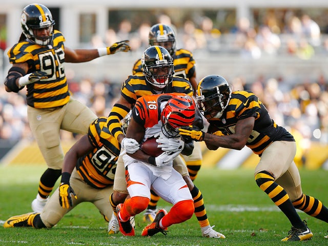 A.J. Green #18 of the Cincinnati Bengals is tackled by Antwon Blake #41 and Robert Golden #21 of the Pittsburgh Steelers during the 2nd quarter of the game at Heinz Field on November 1, 2015
