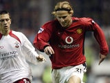 Diego Forlan (right) of Manchester United is closed down by Fabrice Fernandes of Southampton during the FA Barclaycard Premiership match between Manchester United and Southampton on November 2, 2002 played at Old Trafford in Manchester, England. Mancheste