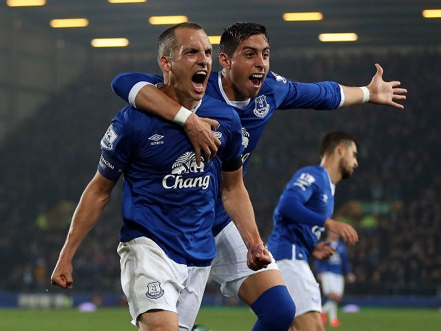 Leon Osman of Everton celebrates scoring his side's first goal with team-mate Ramiro Funes Mori during the Capital One Cup Fourth Round match between Everton and Norwich City at Goodison Park on October 27, 2015 in Liverpool, England.