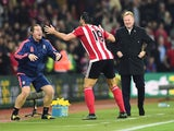 Graziano Pelle of Southampton performs a haka style celebration with Southampton sports therapist Graeme Staddon as he scores their second goal as Ronald Koeman manager of Southampton looks on during the Barclays Premier League match between Southampton a