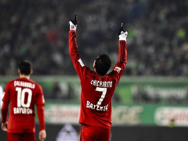 Leverkusen's Mexican forward Javier Hernandez aka Chicharito celebrates scoring during the German first division Bundesliga football match Wolfsburg vs Leverkusen in Wolfsburg on October 31, 2015.