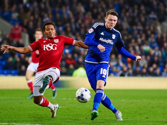 Joe Mason of Cardiff (r) shoots at goal during the Sky Bet Championship match between Cardiff City and Bristol City at Cardiff City Stadium on October 26, 2015 in Cardiff, United Kingdom.