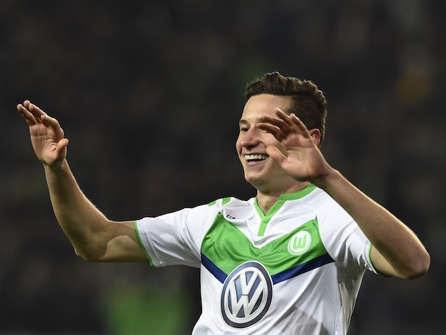 Wolfsburg's midfielder Julian Draxler celebrates scoring during the German first division Bundesliga football match Wolfsburg vs Leverkusen in Wolfsburg on October 31, 2015.
