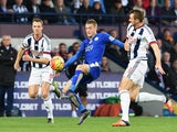 Jamie Vardy (C) of Leicester City controls the ball against Jonny Evans (L) and Gareth McAuley (R) of West Bromwich Albion during the Barclays Premier League match between West Bromwich Albion and Leicester City at The Hawthorns on October 31, 2015