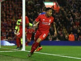 Nathaniel Clyne of Liverpool turns away after scoring the opening goal during the Capital One Cup Fourth Round match between Liverpool and AFC Bournemouth at Anfield on October 28, 2015 in Liverpool, England.