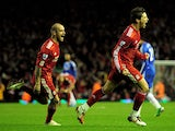 Fernando Torres (R) of Liverpool celebrates scoring his team's second goal with team mate Raul Meireles during the Barclays Premier League match between Liverpool and Chelsea at Anfield on November 7, 2010