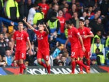 Philippe Coutinho (2nd L) of Liverpool celebrates scoring his team's second goal during the Barclays Premier League match between Chelsea and Liverpool at Stamford Bridge on October 31, 2015