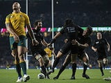 New Zealand's centre Ma'a Nonu (C) celebrates with New Zealand's lock Sam Whitelock (2L) and New Zealand's wing Julian Savea (R) after scoring his team's second try during the final match of the 2015 Rugby World Cup between New Zealand and Australia at Tw