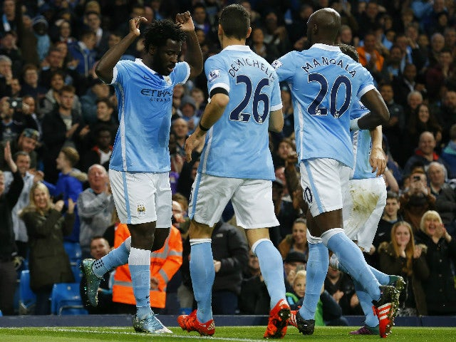 Manchester City's Ivorian striker Wilfried Bony (L) celebrates with teammates after scoring the opening goal during the English League Cup fourth round football match between Manchester City and Crystal Palace at The Etihad Stadium in Manchester, north we