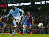 Manchester City's Ivorian midfielder and captain Yaya Toure scores their fourth goal from the penalty spot during the English League Cup fourth round football match between Manchester City and Crystal Palace at The Etihad Stadium in Manchester, north west