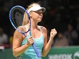 Russia's Maria Sharapova celebrates after beating Italy's Flavia Pennetta during their women's singles round robin tennis match at the WTA Finals in Singapore on October 29, 2015
