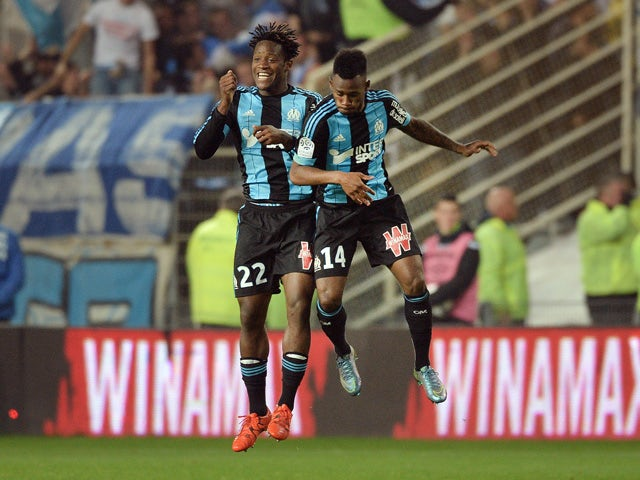 Marseille's French midfielder Georges-Kevin Nkoudou (R) celebrates with Marseille's Belgian forward Michy Batshuayi after scoring a goal during the French L1 football match between Nantes and Marseille at the Beaujoire stadium in Nantes, western France, o