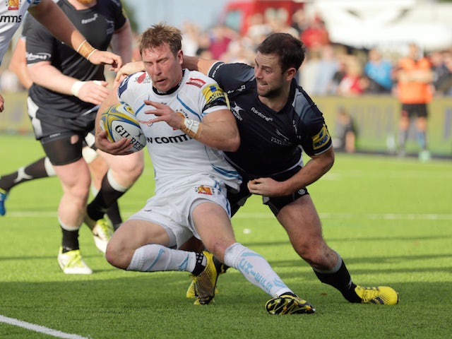 Michael Young (R) of Newcastle Falcons tackles Will Chudley of Exeter Chiefs during the Aviva Premiership match between Newcastle Falcons and Exeter Chiefs at Kingston Park on November 1, 2015 in Newcastle upon Tyne, England.
