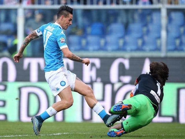 Napoli's midfielder from Slovakia Marek Hamsik tries to score against Genoa's goalkeeper from Italy Mattia Perin during the Italian Serie A football match Genoa Vs Napoli on November 1, 2015
