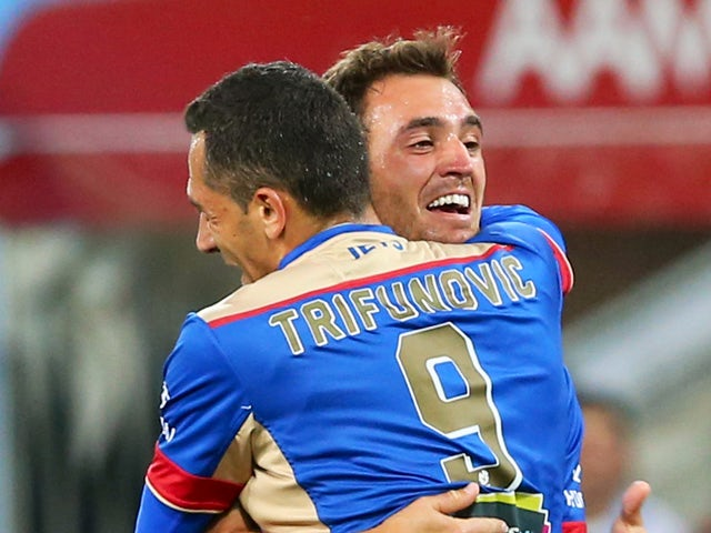 Benjamin Kantarovsji of the Jets is congartulated by Milos Trifunovic after scoring a goal during the round four A-League match between Melbourne City FC and Newcastle Jets at AAMI Park on October 30, 2015