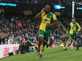 Cameron Jerome of Norwich City celebrates scoring his team's first goal during the Barclays Premier League match between Manchester City and Norwich City at Etihad Stadium on October 31, 2015