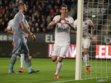 Paris Saint-Germain's Argentinian forward Angel Di Maria (C) celebrates after scoring a goal during the French L1 football match between Rennes and Paris Saint-Germain on October 30, 2015