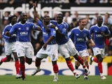 Noe Pamarot (C) of Portsmouth celebrates scoring his teams first goal during the Barclays Premier League match between Newcastle United and Portsmouth at St.James Park on November 03, 2007 in Newcastle, England.