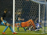 Sheffield Wednesday's English defender Sam Hutchinson (R) beats Arsenal's Czech goalkeeper Petr Cech (C) to score the team's third goal during the English League Cup fourth round football match between Sheffield Wednesday and Arsenal at The Hillsborough S