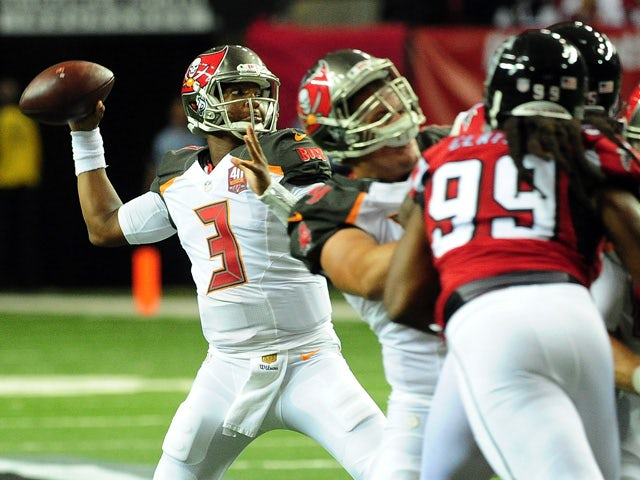 Jameis Winston #3 of the Tampa Bay Buccaneers drops back to pass during the first half against the Atlanta Falcons at the Georgia Dome on November 1, 2015