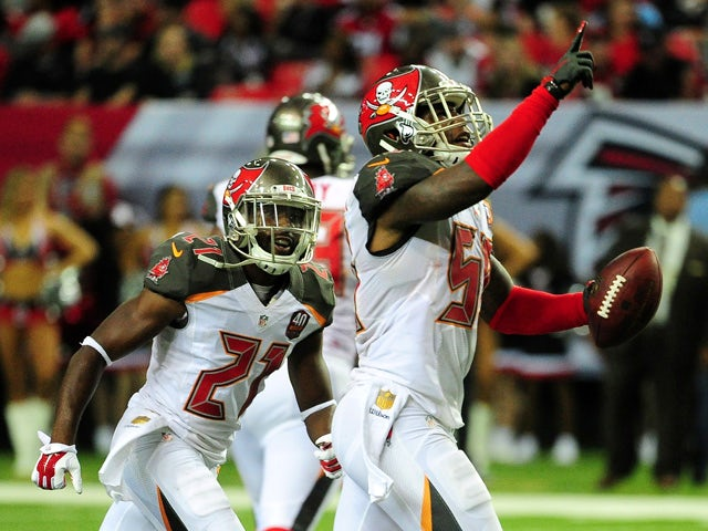 Kwon Alexander #58 of the Tampa Bay Buccaneers celebrates an interception during the first half against the Atlanta Falcons at the Georgia Dome on November 1, 2015