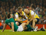 Tommy Bowe of Ireland receives treatment for an injury during the 2015 Rugby World Cup Quarter Final match between Ireland and Argentina at the Millennium Stadium on October 18, 2015