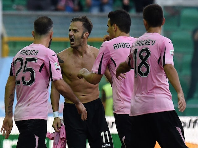 Alberto Gilardino of Palermo celebrates with team mates after scoring the opening goal during the Serie A match between US Citta di Palermo and AC Chievo Verona at Stadio Renzo Barbera on November 8, 2015 in Palermo, Italy.