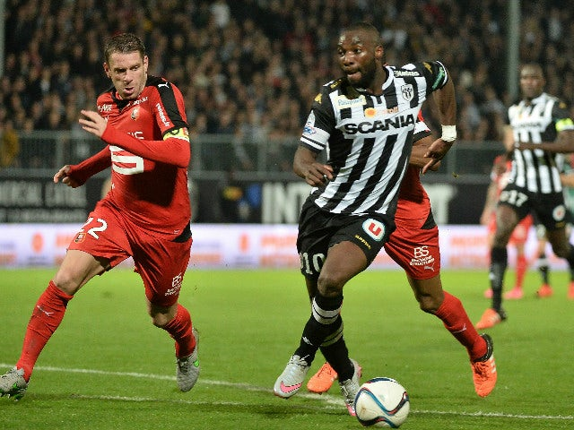 Angers French Forward Gilles Sunu R Evades Rennes French Defender Sylvain Armand