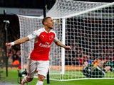 Kieran Gibbs of Arsenal celebrates scoring his side's first goal during the Barclays Premier League match between Arsenal and Tottenham Hotspur at the Emirates Stadium on November 8, 2015