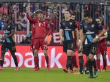 Bayern Munich's German striker Thomas Muller (3rd L) celebrates scoring with his teammates during the UEFA Champions League Group F second-leg football match between FC Bayern Munich and Arsenal FC in Munich, southern Germany, on November 4, 2015