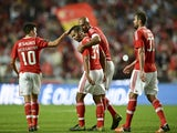 Benfica's Belgian midfielder Mehdi Carcela Gonzalez (2ndL) celebrates with his teammates after scored against Boavista FC during the Portuguese league football match SL Benfica vs Boavista FC at the Luz stadium in Lisbon on November 8, 2015
