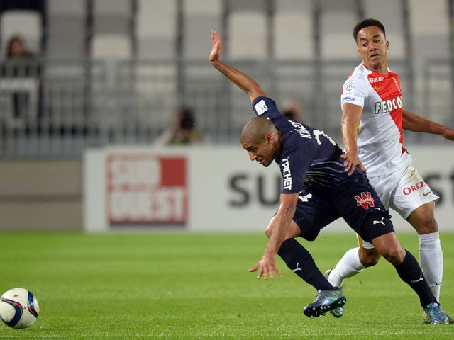 Bordeaux's Tunisian midfielder Wahbi Khazri (L) challenges Monaco's forward Helder Costa (R) during the French L1 football match between Bordeaux and Monaco at the Matmut Atlantique stadium in Bordeaux, southwestern France, on November 8, 2015