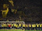 Dortmund's players celebrate with the fans after the German first division football Bundesliga match Borussia Dortmund vs FC Schalke 04 on November 8, 2015, 2015 in Dortmund, western Germany. Dortmund won the derby 3-2.