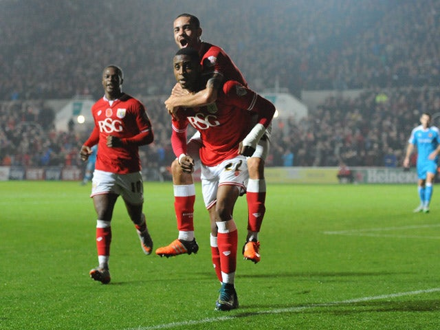 Jonathan Kodjia of Bristol City celebrates his sides goal with Derrick Williams of Bristol City on his shoulders during the Sky Bet Championship match between Bristol City and Wolverhampton Wanderers at Ashton Gate on November 3, 2015