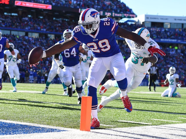 Karlos Williams #29 of the Buffalo Bills scores a touchdown past Michael Thomas #31 of the Miami Dolphins during the first half at Ralph Wilson Stadium on November 8, 2015