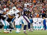 Dion Lewis #33 of the New England Patriots scores a touchdown during the second quarter against the Miami Dolphins at Gillette Stadium on October 29, 2015