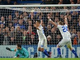 Chelsea's Bosnian goalkeeper Asmir Begovic (L) fails to save a shot by Dynamo Kiev's Austrian defender Aleksandar Dragovic (not in picture) to make it 1-1 during a UEFA Chamions league group stage football match between Chelsea and Dynamo Kiev at Stamford
