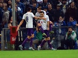 Fiorentina's forward from Croatia Nikola Kalinic (C) celebrates with teammates after scoring during the Italian Seria A football match Sampdoria vs Fiorentina, on November 8, 2015
