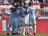 Geoffrey Kondogbia (C) of FC Internazionale Milano celebrates after scoring the opening goal with team mates during the Serie A match between Torino FC and FC Internazionale Milano at Stadio Olimpico di Torino on November 8, 2015 in Turin, Italy.