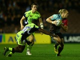 Matt Hopper of Harlequins is tackled by Nev Edwards of Sale Sharks during the Aviva Premiership match between Harlequins and Sale Sharks at Twickenham Stoop on November 6, 2015 in London, England.