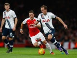 Harry Kane of Spurs (r) takes on Mesut Oezil of Arsenal during the Barclays Premier League match between Arsenal and Tottenham Hotspur at the Emirates Stadium on November 8, 2015 in London, England.
