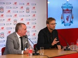 Jurgen Klopp sits alongside the chief executive Ian Ayre as he is unveiled as the new manager of Liverpool FC during a press conference at Anfield on October 9, 2015