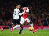 Joel Campbell of Arsenal (r) holds off Dele Alli of Spurs during the Barclays Premier League match between Arsenal and Tottenham Hotspur at the Emirates Stadium on November 8, 2015 in London, England.